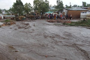 Floodwater rushes through township near Malawi capital Blantyre