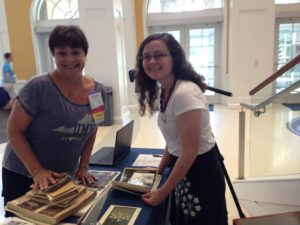 Vicki Sprague Ravenel, '77 with Angie White, Digital Resources Librarian, at our History Harvest table. Vicki brought us some wonderful photographs from the seventies!